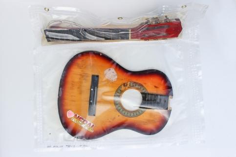 """29/34, """"Nepal Gitarre"""", 66x57cm, zweiteilig, Holz, Metall, Wasser aus dem Tauchcontainer, Folie und Nieten"""